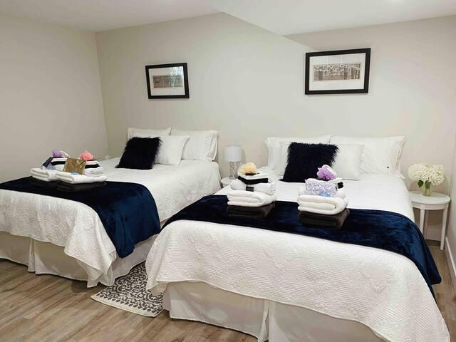 Spacious bedroom with 2 queen beds