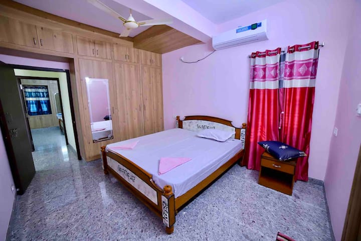 Our AC master bedroom with private bathroom. Fresh bedsheets and pillow covers. Extra bed for one more person to sleep