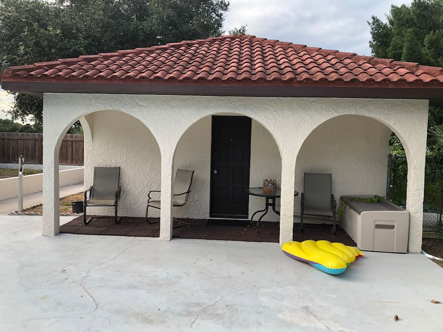 Back of house door to the pool , covers and sitting area.