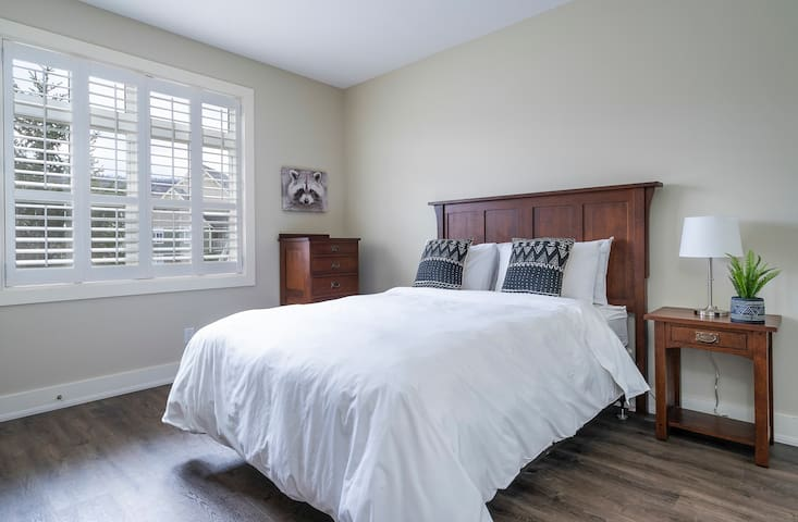 Bedroom located on the main floor featuring a Queen Bed.