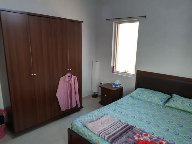 1 Private Bedroom Furnished with Seperate Bath