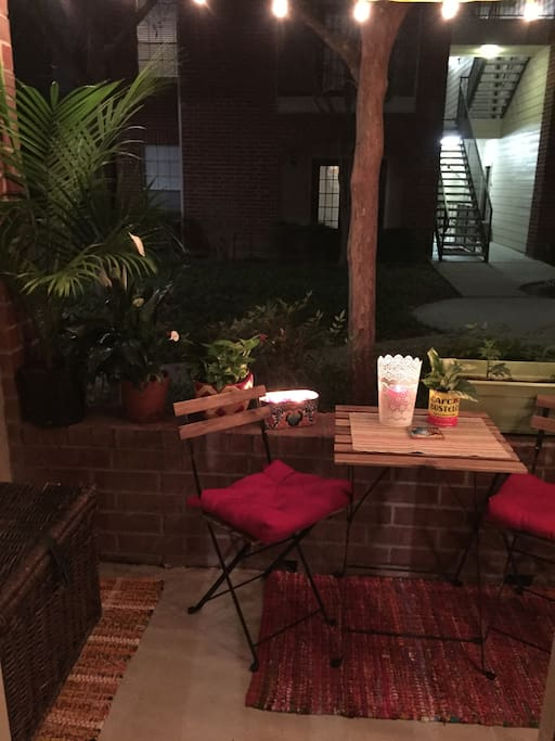 Outdoor patio area with small patio table and two chairs