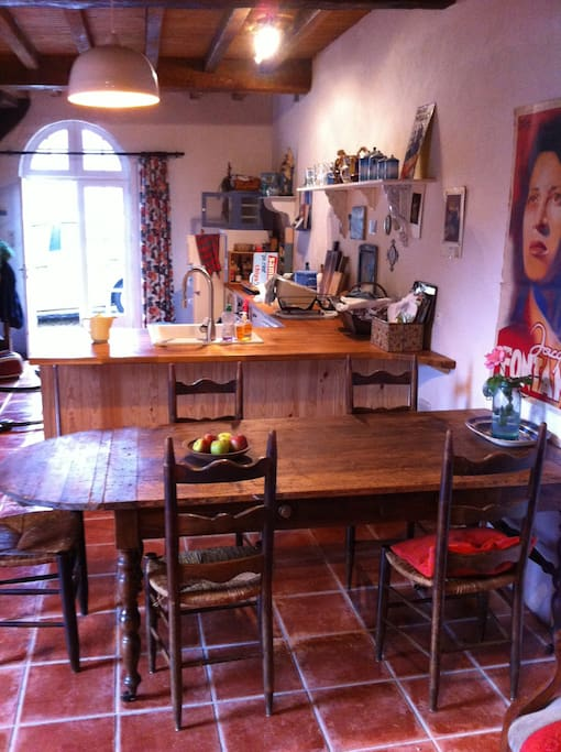 A genuine ancient farm table takes centre place in the dining area