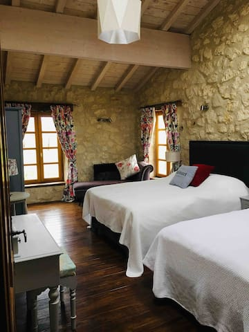 The Lavande room - pool facing with two double beds and en suite shower room / WC.