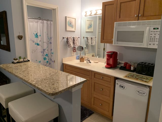 Kitchenette with breakfast bar.  Private bathroom.