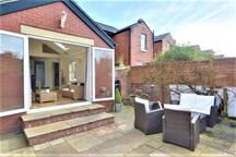 Rear seating area and patio with gas BBQ