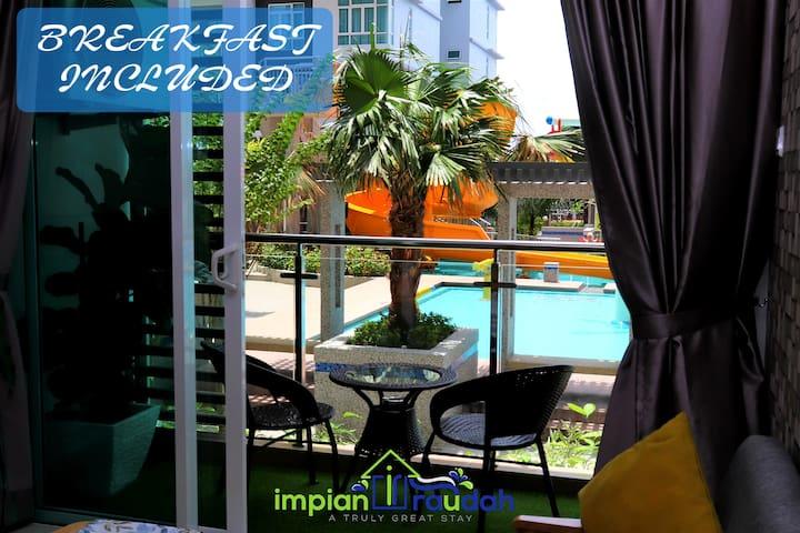 Impian Raudah muslim in front pool in malacca town