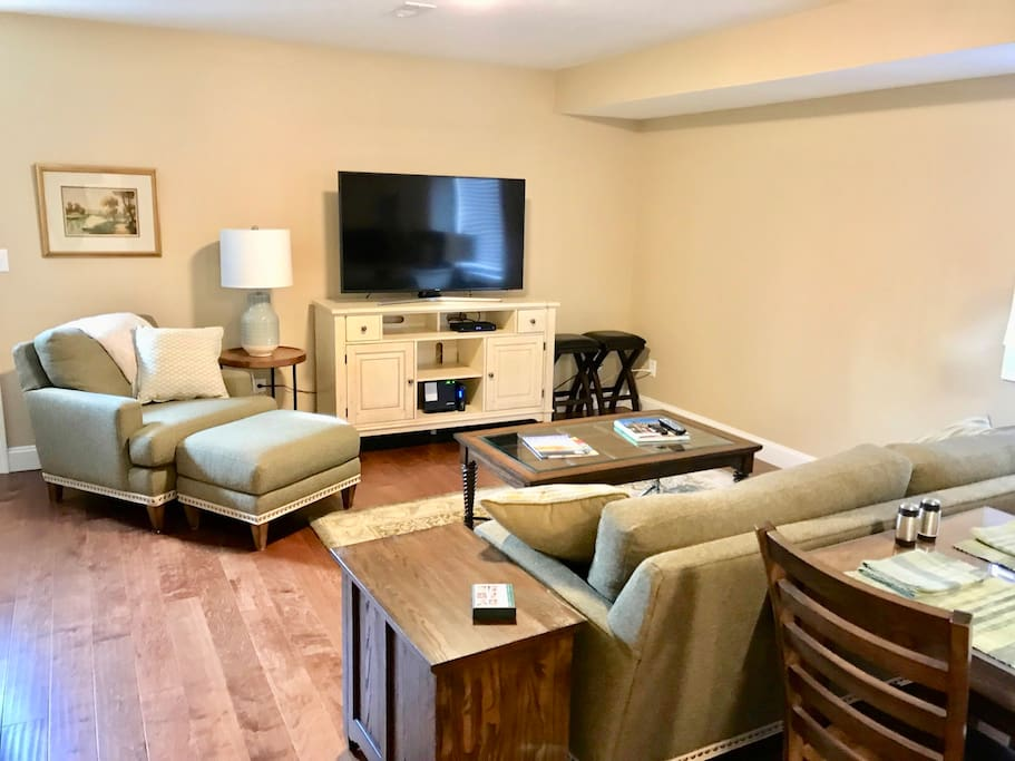 """Open floor plan offers all new upscale furnishings with an ultra high def 55"""" television."""