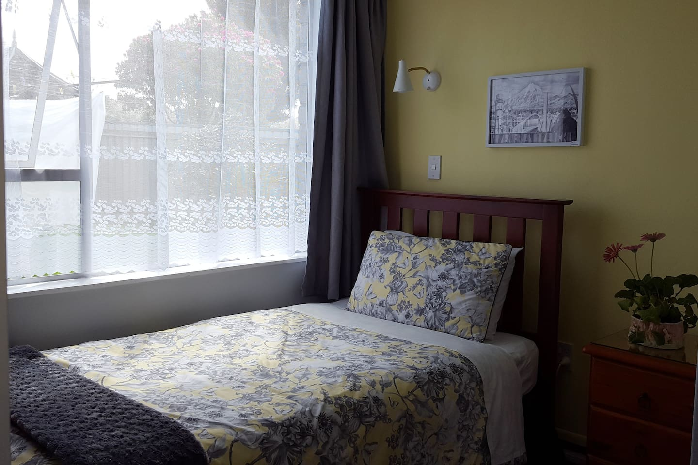 Room 1 has a vanity, TV, wardrobe and a view to the vege gardens.