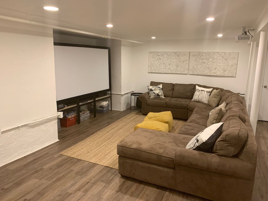 Large finished basement with projector screen, toys and games