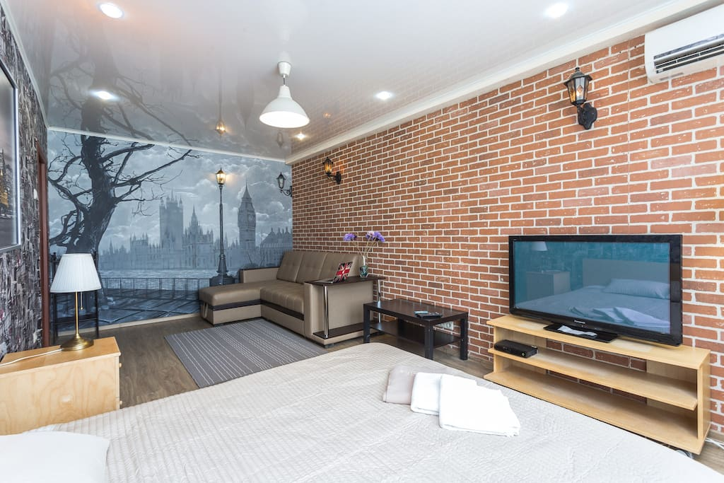 Master bedroom has a large screen TV, sofa bed, and king-size bed with new orthopedic mattress.