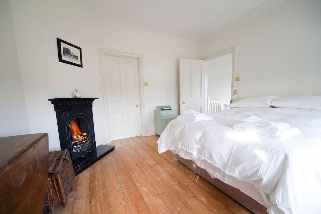 Master bedroom with indoor fireplace