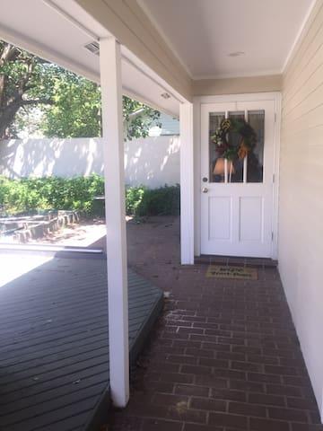 Entryway to front door of apartment