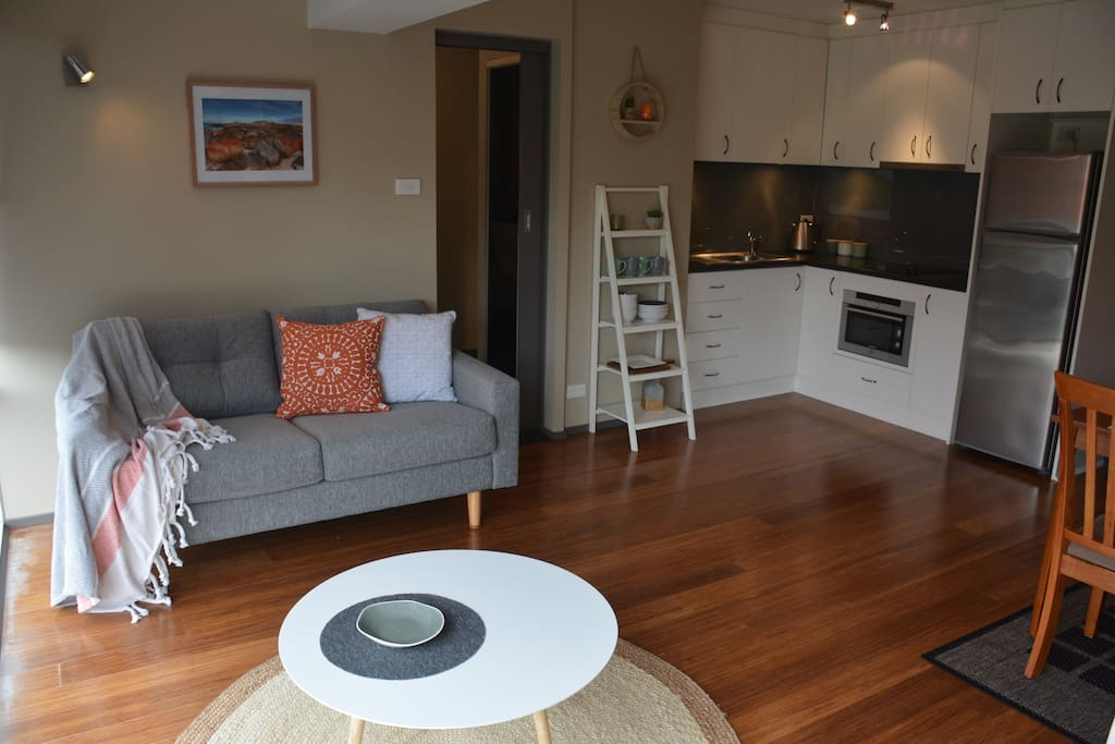Open plan living, timber floors, natural colours and lots of light