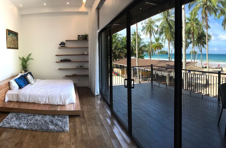 Master bedroom with 8.2meter window . The one and only at the Palawan.