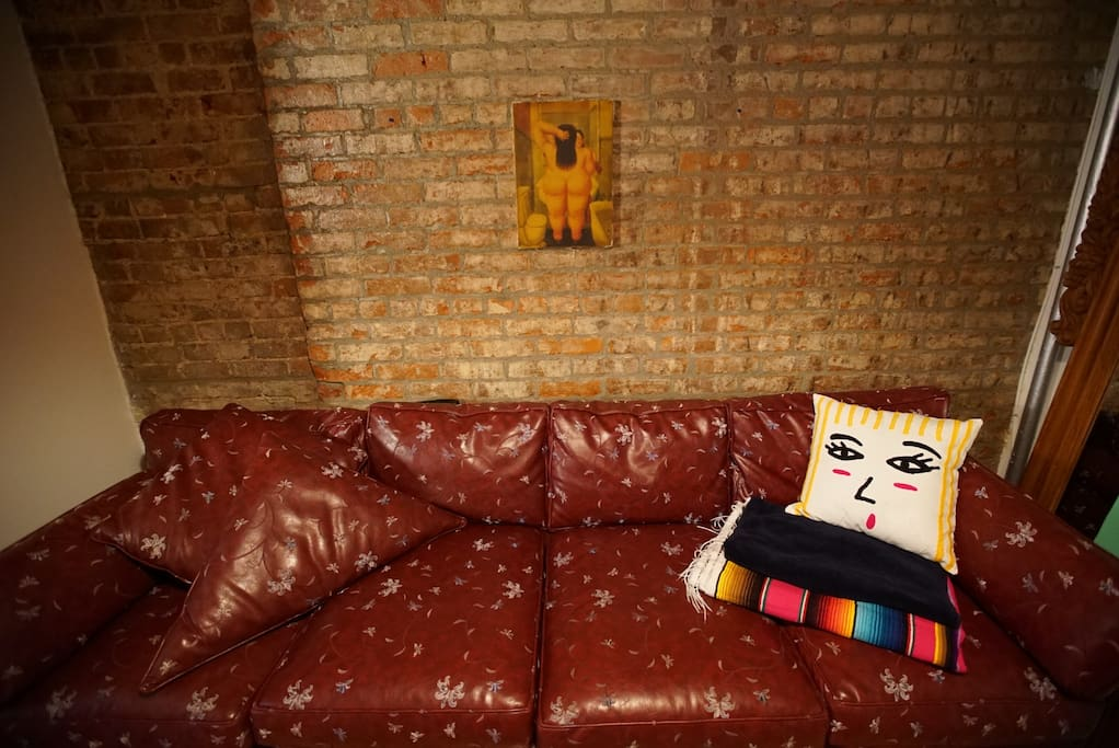 Our Botero with a little face on the couch