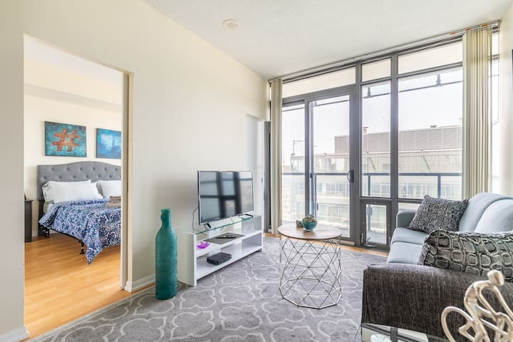 Bright, spacious suite with floor to ceiling windows and hardwood floors