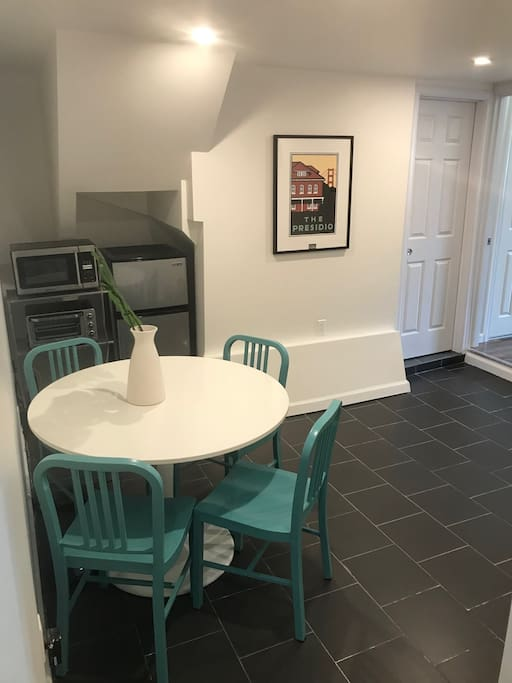 Dining room for 4, medium fridge, toaster and microwave available