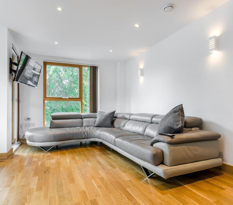 Enormous  sofa and flat screen TV