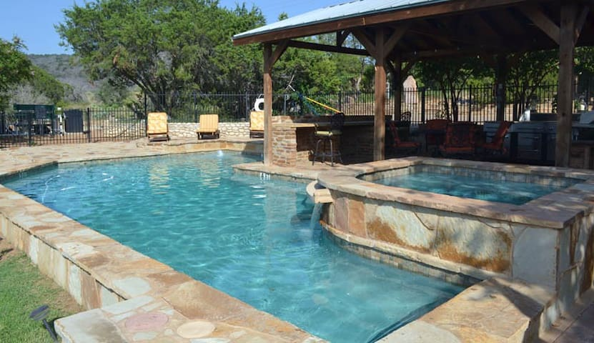 Breathtaking views of Texas Hill Country and amenities galore sleeping 30