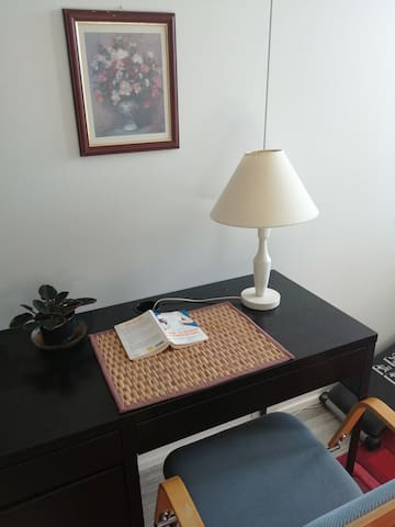 Comfortable desk and Wifi in private room for guests.