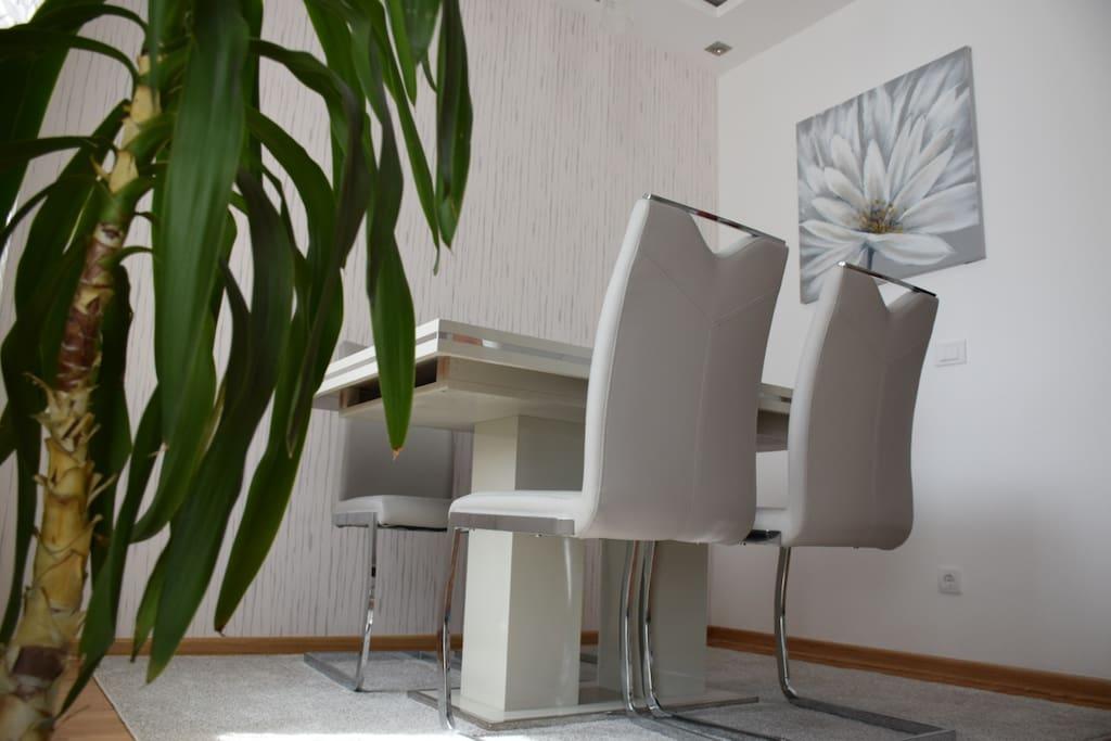 Peaceful dinning room with good lighting and big window
