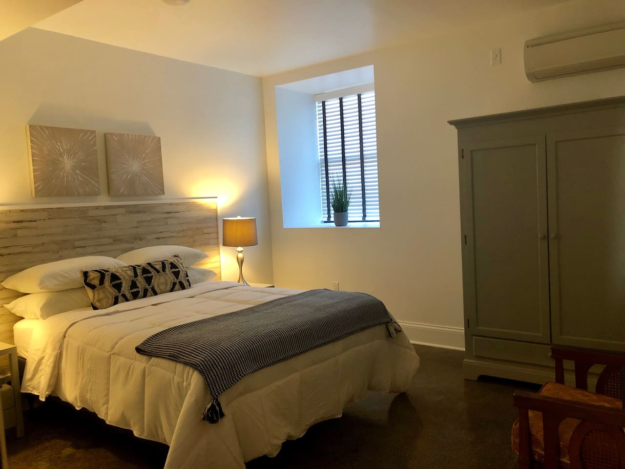 This spacious room is calming and warm. We love the subtle grey hues, and relaxing blue touches. Located conveniently close to the restrooms and sitting area.
