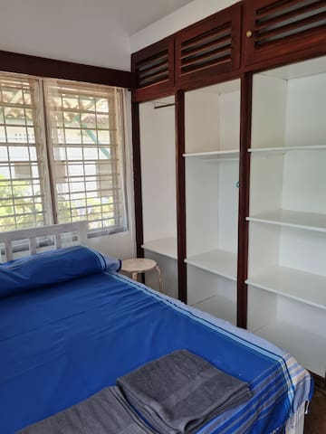 Double bedroom with lots of cupboards and wardrobe space. Overhead fan and mosi nets on windows
