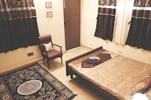 Double bedroom with AC which comes with a separate entrance and attached bathroom
