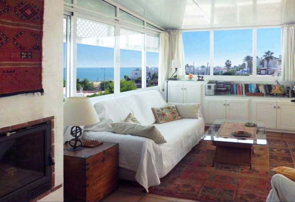 Open living room with sea & mountain views