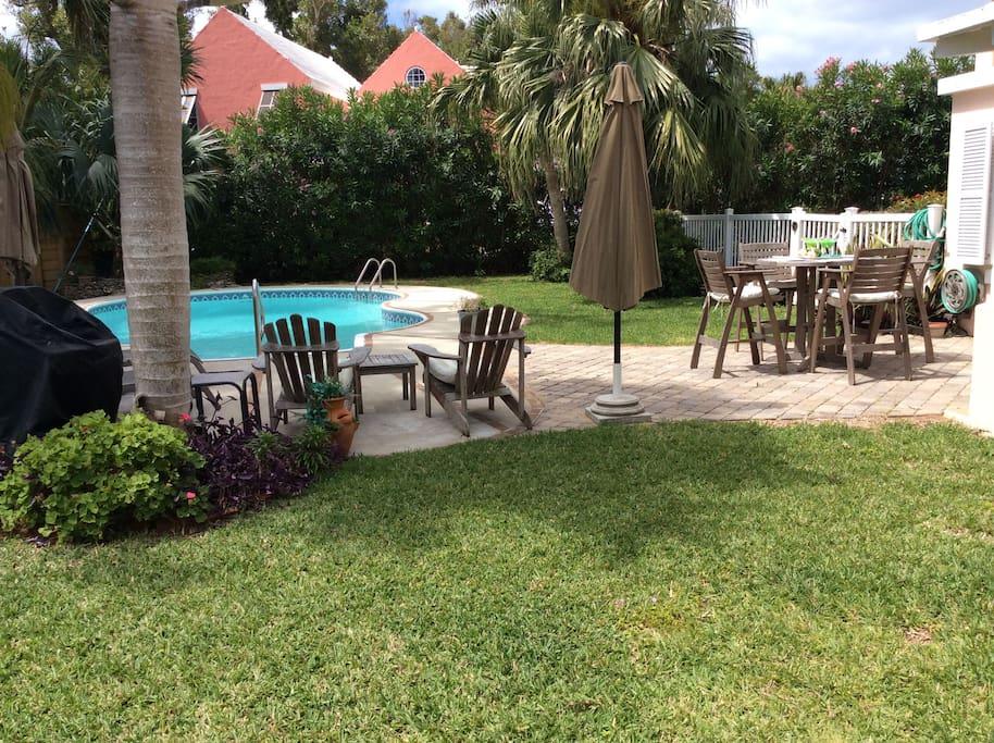 backyard, pool and pub table seating for 4