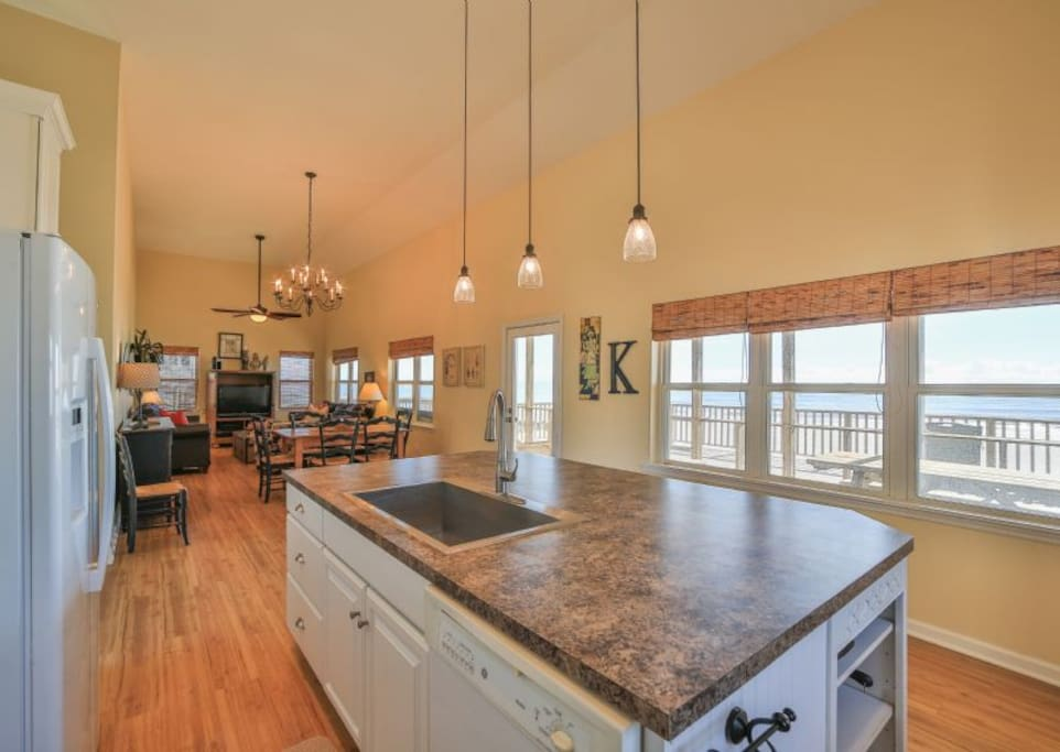 open, oceanfront kitchen, dining & living area