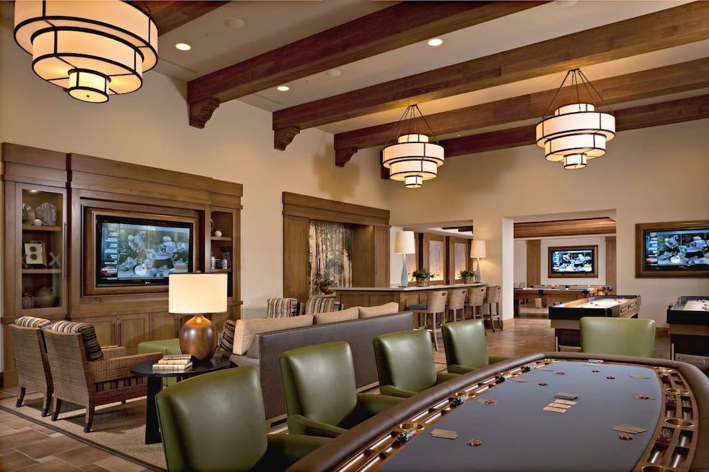 One of the clubhouses, has 2 pool tables, a poker table, and huge TVs