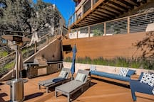 BBQ with your group, watch TV, layout on the chaise lounge chairs, and hop in the spa! The downstairs deck is the ultimate spot to enjoy a vacation in 90210.