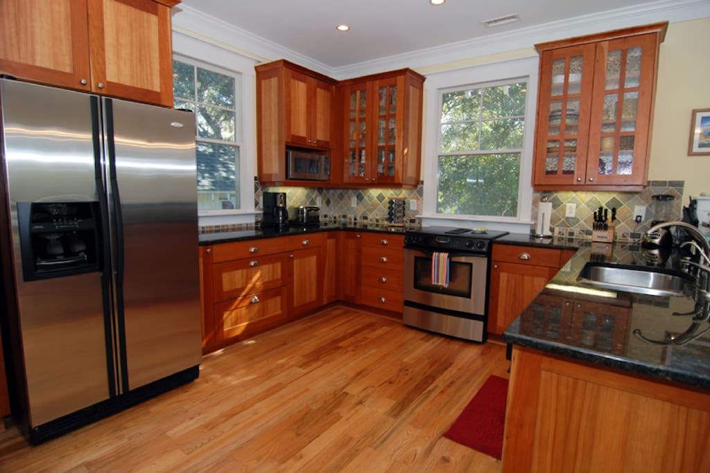 Fully-equipped gourmet kitchen, with cherry cabinets, granite, and stainless appliances, of course!!