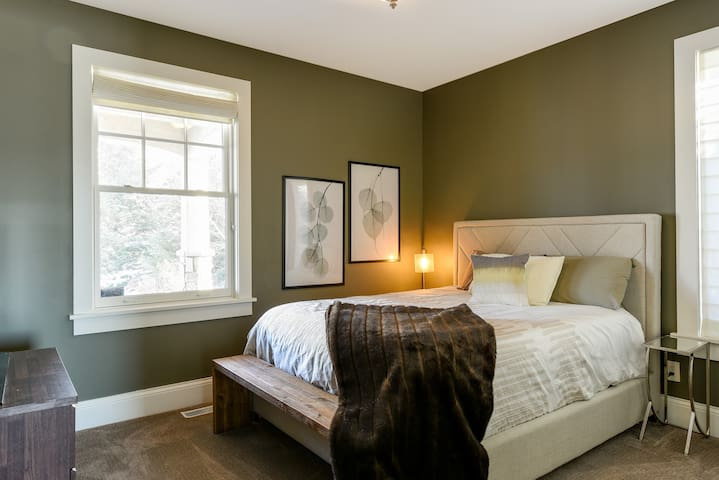 Main floor guest bedroom - QUEEN BED- Full bath located right outside door across from the office