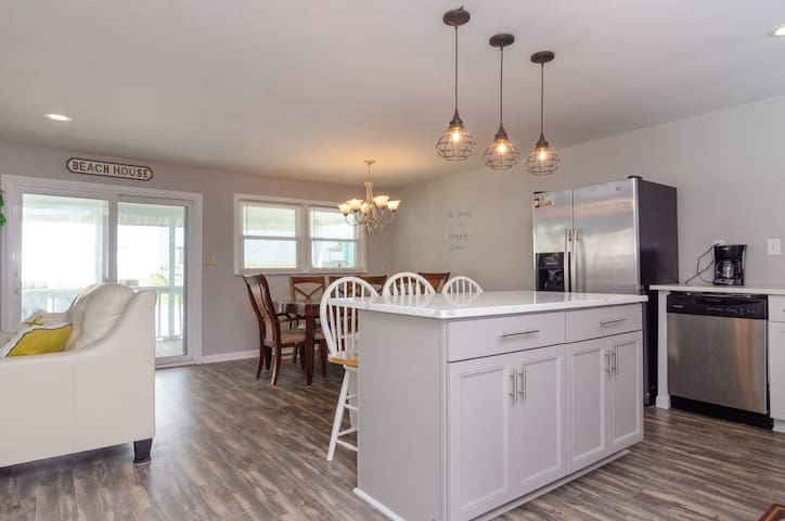 Open kitchen, dining and living areas.