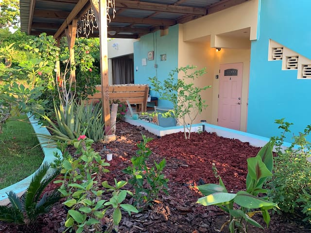 Private patio, deck and door to Royal Palm suite A surrounded by herbs and tropical flowers!