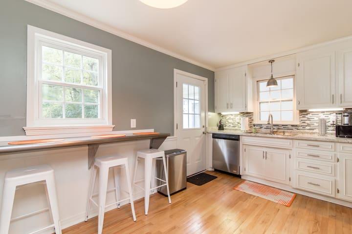 Kitchen, alternate view with breakfast bar.