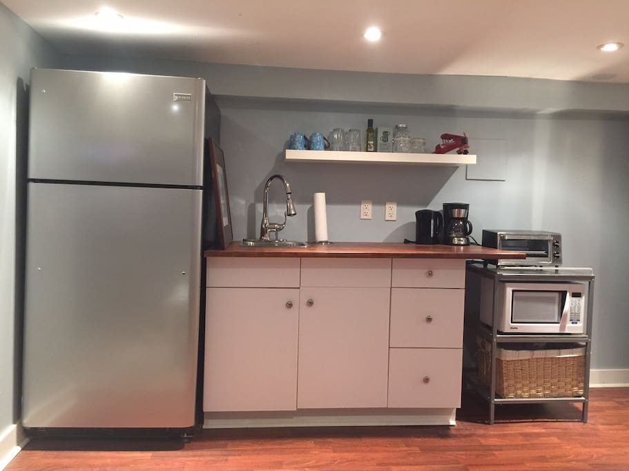 It's your little home away from home. The kitchen area includes fridge, microwave, toaster oven, kettle and coffee maker. Dishes, mugs and glasses too. Enjoy the great restaurants nearby and save money by making a few meals of your own.