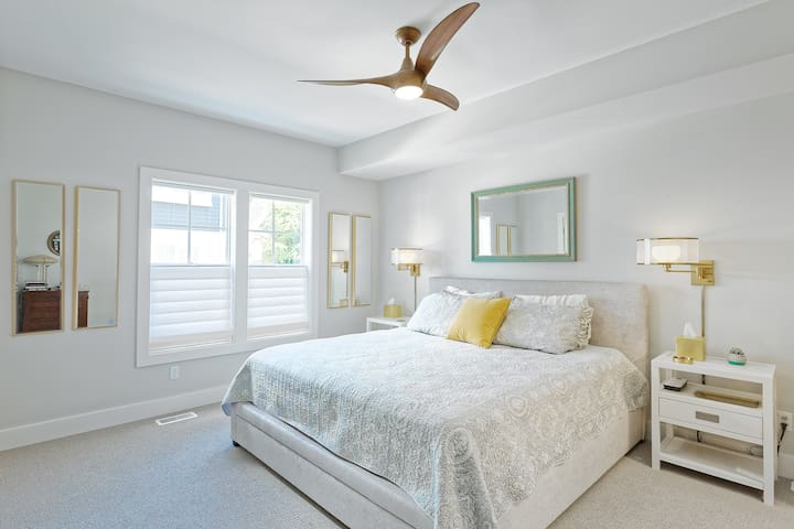 Large master bedroom on first floor with attached master bedroom. King size bed, closet, and dresser.