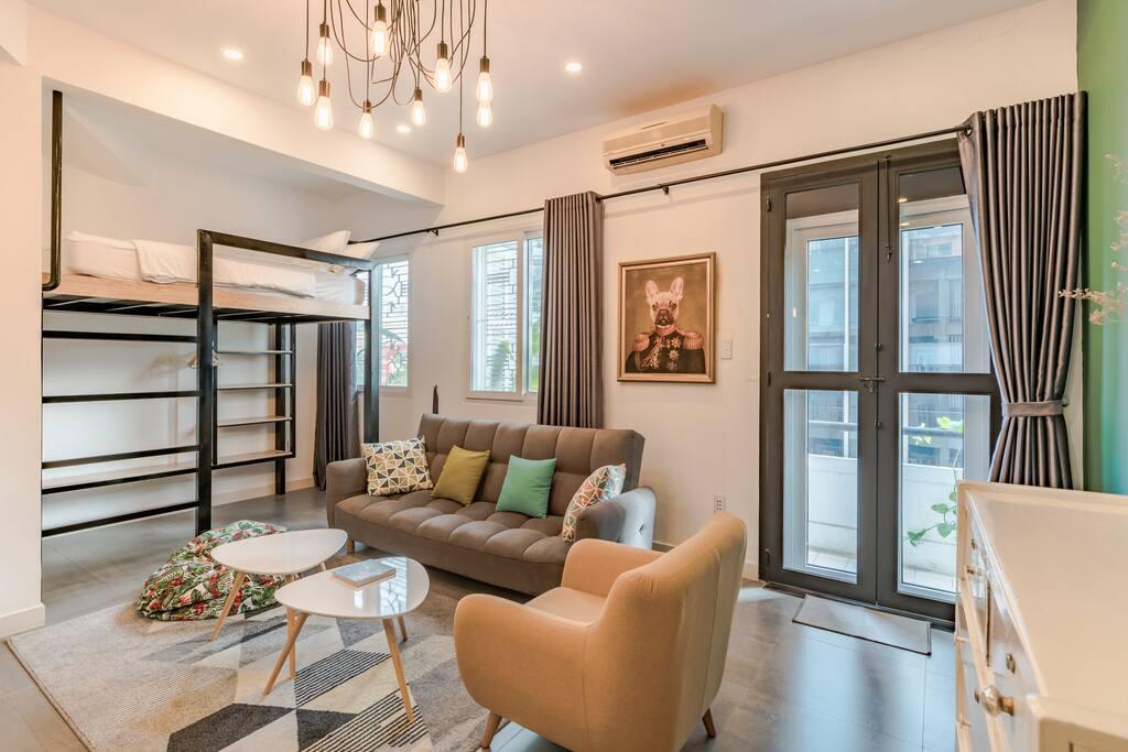 Living room with sofa, armchair and beanbag