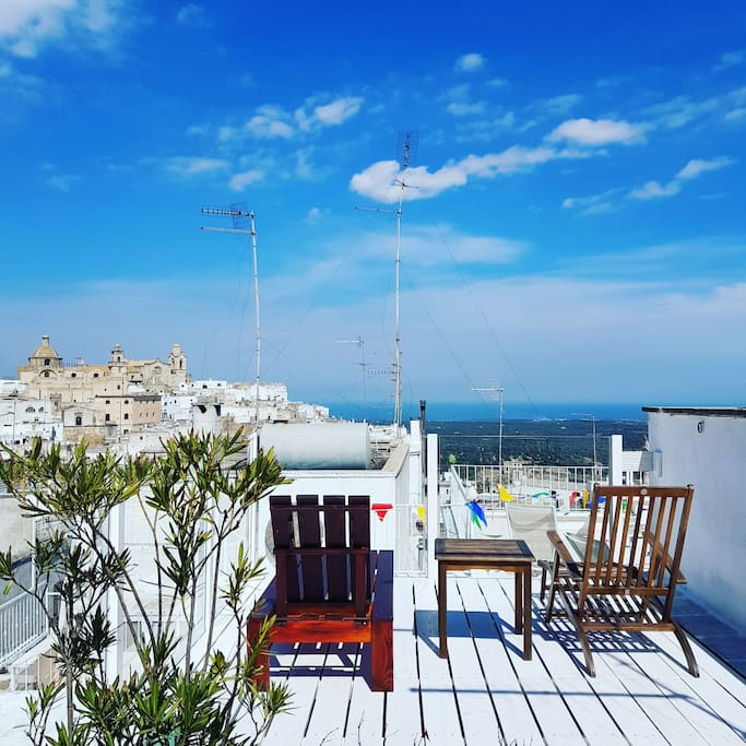 Relax under the sun complete with amazing view of Ostuni's medieval centre and the blue Adriatic sea on the background