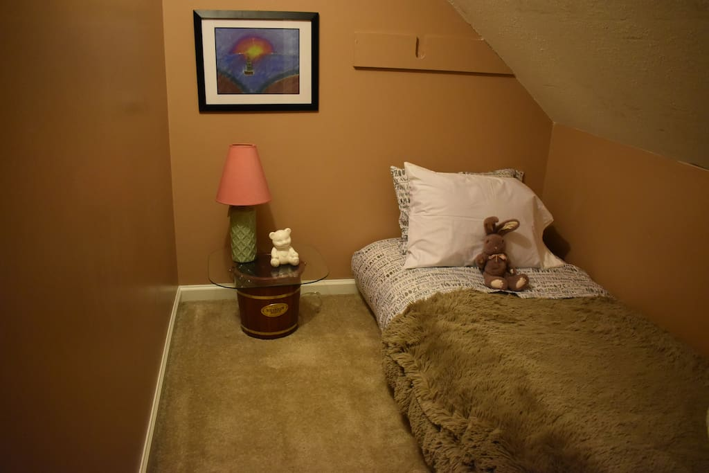 There is a door that can be closed to separtate this cute little room from the master suite. The floor mattress is very comfortable and perfect fort for your little person,.. or big one if necessary!