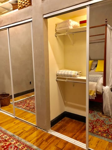 The closet spaces is quite large with shelving and plenty of hangers for clothing.  Extra linens and blankets are available.