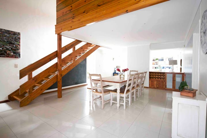 Bright, spacious dining room with large barn-style table