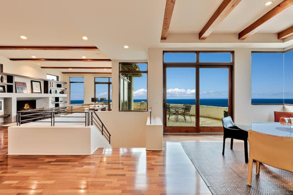 Expansive wooden floors leading to the outside patio.