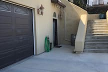Studio apartment with private entrance and wine barrel bistro set to enjoy your morning coffee or a glass of wine.  Our home is up above.  Safe, private, off street parking is to the left of the garage.