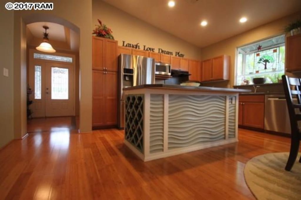 Kitchen with island and wine rack