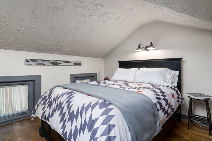 Cushy bed, cozy environment.. beautiful art.. sweet dreams!